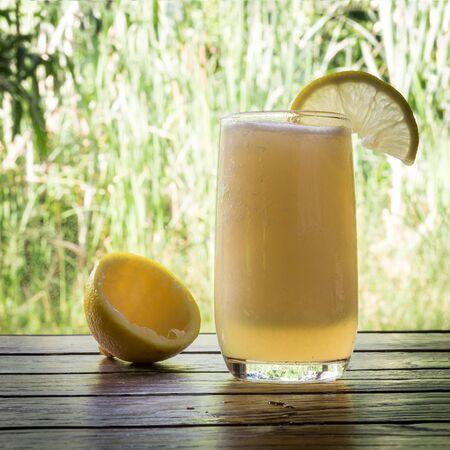 frash: lemon juice on wood table frash organic food
