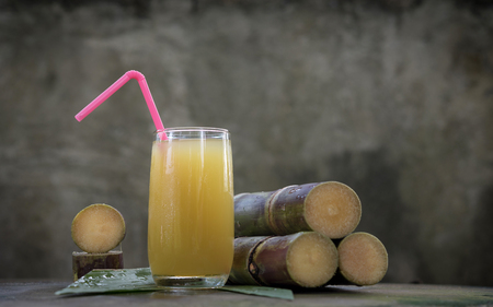 Piece of sugarcane juice over white background