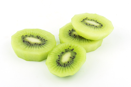 sliced Kiwi fruit isolated on white background cutout juice Фото со стока
