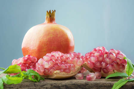 pomegranates with leaves Stock Photo