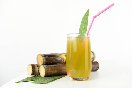 molasses: Fresh sugar cane juice in glass on white background