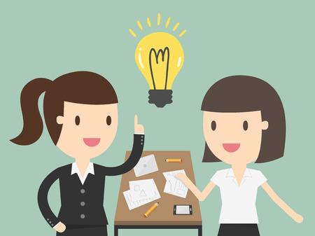 ビジネスの女性会議で同僚に財務計画を説明します。