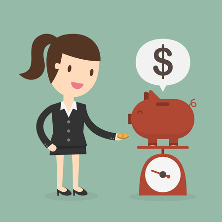 Business woman saving money in a piggy bank 版權商用圖片 - 53139144