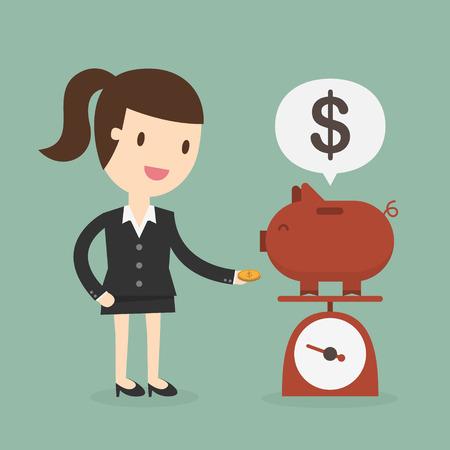 Business woman saving money in a piggy bank