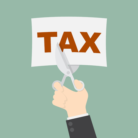 reduce taxes: businessman trying to cut tax with scissor