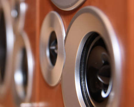Black hi-fi speakers in wooden boxes in perspective view