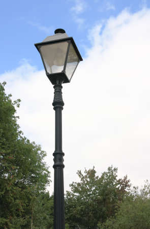 Lamppost in the park in cloudy summer day Standard-Bild
