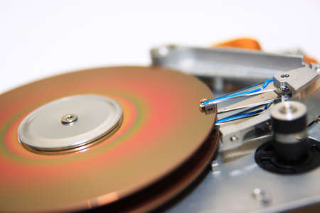 Close-up view of head and disk of HDD photo