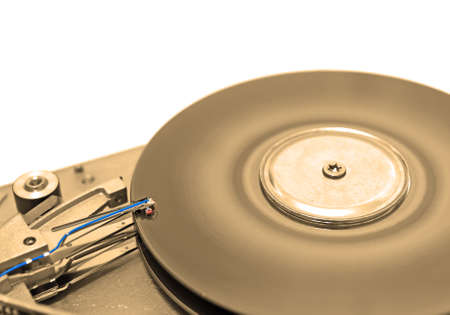 Close-up view of head and disk of HDD in sepia Standard-Bild