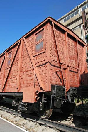 Brown railroad wagon waiting in the station Standard-Bild