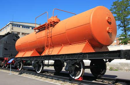 Orange railroad wagon waiting in the station