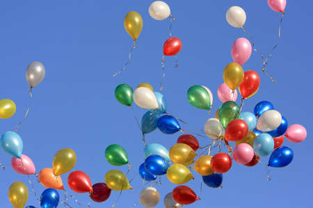 A lot of balloons in the blue sky.