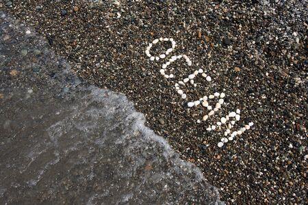 Ocean word on the pebbles with water Standard-Bild