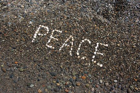 Peace word on the pebbles