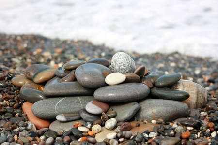 Heap of the sea pebbles in the beach