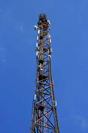 Broadcasting tower with a lot of TV, radio and cellular antennas Standard-Bild