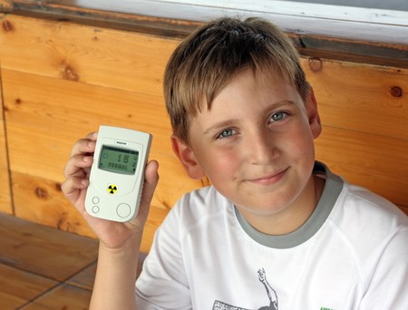 gamma radiation: Boy with hand radiometer check the radiation pollution Stock Photo