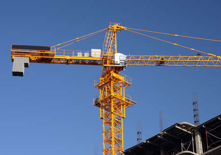 gibbet: Yellow construction crane in midday