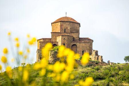 crist: Jvari Monastery on mountain. It is a 6-th century Georgian Orthodox monastery near Mtskheta, Georgia.