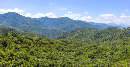 Hills and forests seen from above. Stock Photo