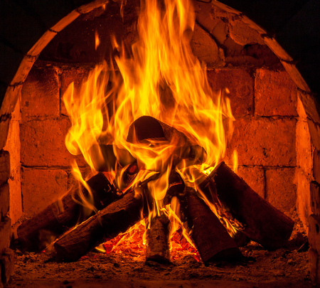 yule log: A fire burns in a fireplace. Stock Photo