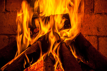 A fire burns in a fireplace. Stock Photo