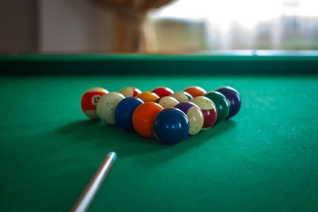 snooker hall: Billiard balls on green table with billiard cue Stock Photo
