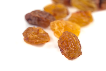 Dried grape raisins on a white background. Banque d'images