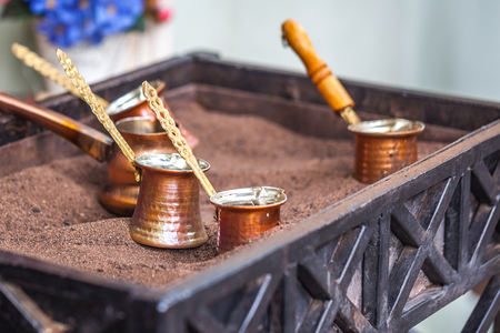 Turkish coffee prepared on hot sand for an unique taste and aroma.