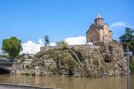 Metekhi church and Houses on the edge of a cliff above the river Kura. Tbilisi, the historic city center.