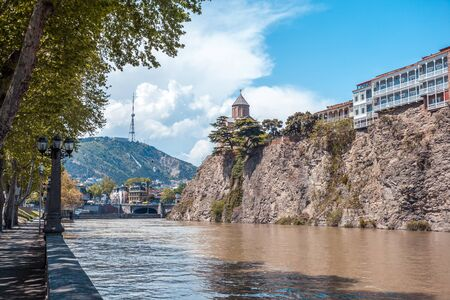 apartment: Metekhi church and Houses on the edge of a cliff above the river Kura. Tbilisi, the historic city center.