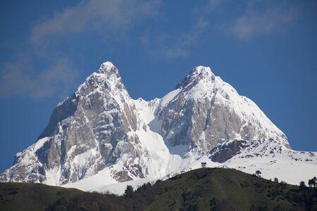 Peak of mount Ushba in Caucasus Mountains, Svanetia region in Georgia, 4700 m. Stock Photo