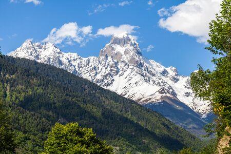 Peak of mount Ushba in Caucasus Mountains, Svanetia region in Georgia, 4700 m. Imagens