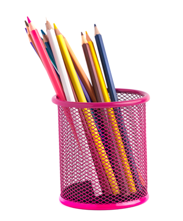 color pencils in the red metal grid container isolated on white with clipping path. Stock Photo