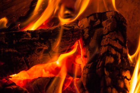 yule log: A fire burns in a fireplace, Fire to keep warm.