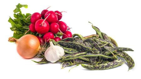Fresh Borlotti Beans, radish and ather vegetable on a white backgronud.