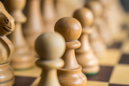 Set of chess figures on the playing board.