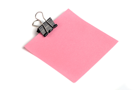 Black Paper clip and pink paper isolated on white background.