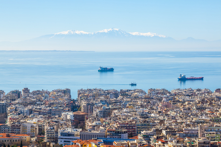 View of Thessaloniki city, the sea, ships and the olympous mountain. Stock Photo