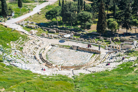 Ruins of ancient theater of Dionysus seen from the hill of Athens Acropolis, Greece.