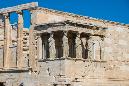 Erechtheion and Temple of Athene at the Acropolis hill in Greece. Caryatids at Erechtheum of Parthenon.