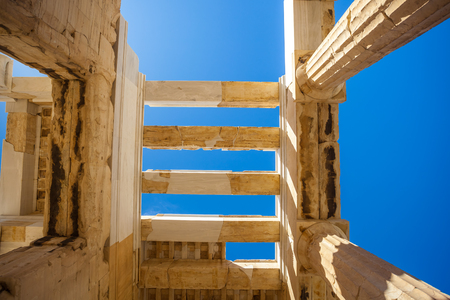 Looking up at a columns of Propylaea gateway in Acropolis of Athens, Greece. Stok Fotoğraf