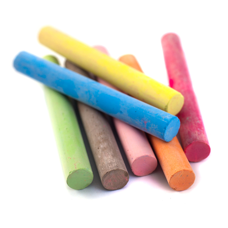Colored chalks on white background with soft shadows. Stock Photo