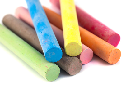 Colored chalks on white background with soft shadows. Stok Fotoğraf
