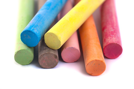 Colored chalks on white background with soft shadows. Archivio Fotografico