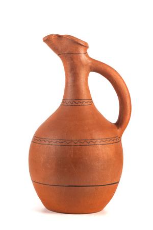 Georgian handmade ceramic jug, named Doqi, for wine and water on white background. Фото со стока