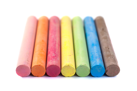 Colored chalks on white background with soft shadows. Фото со стока