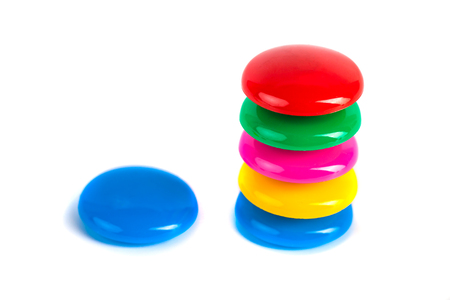 Colorful magnets - holders on a white background. Stock Photo