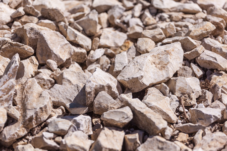 Rocks, small rocks or gravel. Used for construction of buildings, roads and for landscaping. Banco de Imagens - 105855586