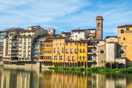 Colorful old buildings line the Arno River in Florence, Italy. Editoriali